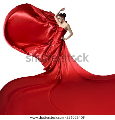 Young beauty woman in fluttering red dress. Isolated on white background. - stock photo