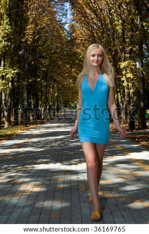 young beauty woman in park outdoor