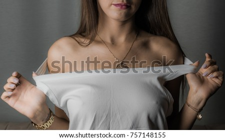 Young beauty woman in white undershirt and no bra.
