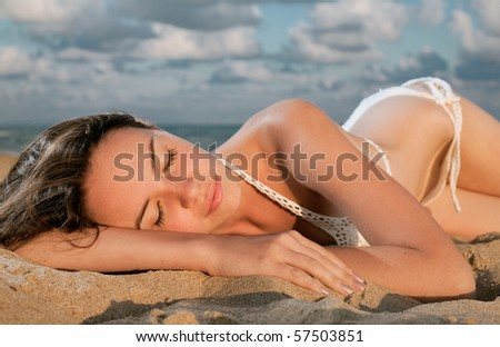 young beauty woman on sea under sky - stock photo
