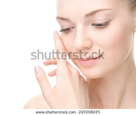 Young beauty woman portrait. Studio shot.  Girl Touching her Face. Isolate on white. Health Care, cosmetic concept. Blank for commercial advertising