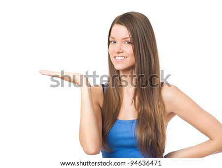 Young beauty woman showing empty palm for product placement - stock photo