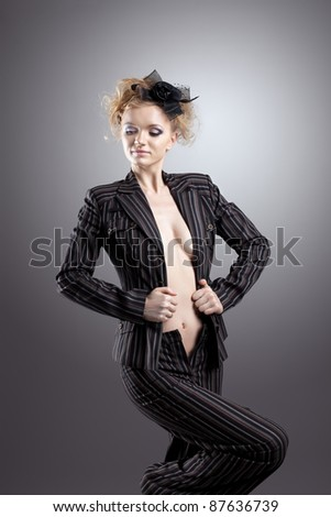 Young beauty woman with nude breast in retro suit - stock photo