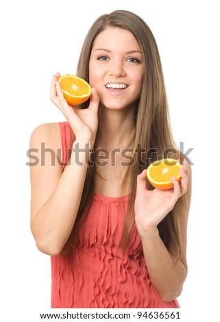 Young beauty woman with orange fruits - stock photo