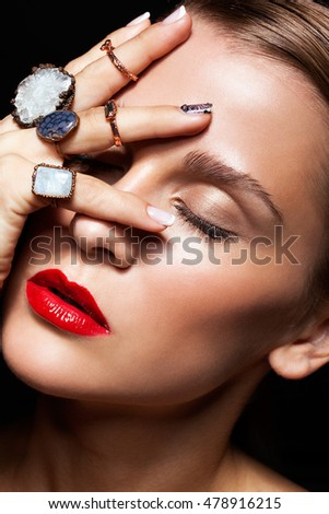 Young beauty woman  with  with many bijouterie rings with stones on fingers