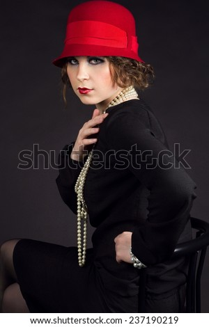 Young beuriful woman in style of 1920 like Coco Chanel  - stock photo