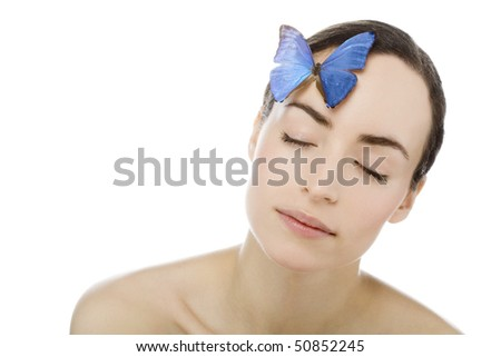 young beutiful woman with butterfly on her - stock photo