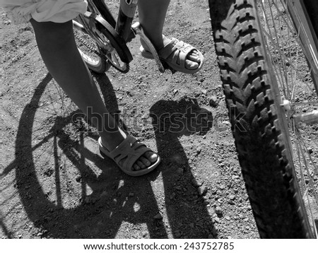 young bicyclist stopped to rest in black and white - stock photo
