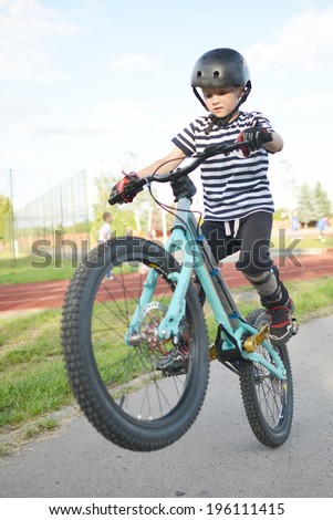 Young Biker Jumping