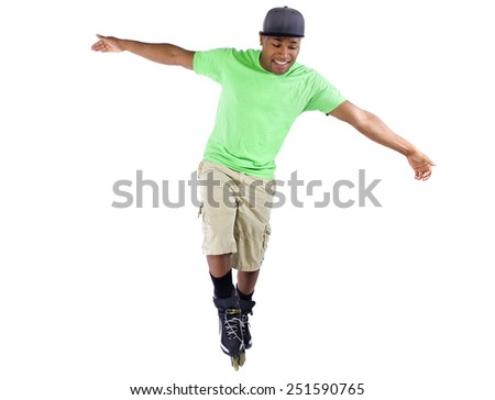 young black adult learning to balance on rollerblade skates - stock photo