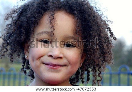Young black baby girl with curly hair 2 - stock photo