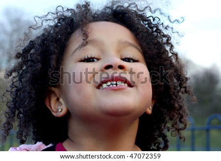 Young black baby girl with curly hair 4 - stock photo
