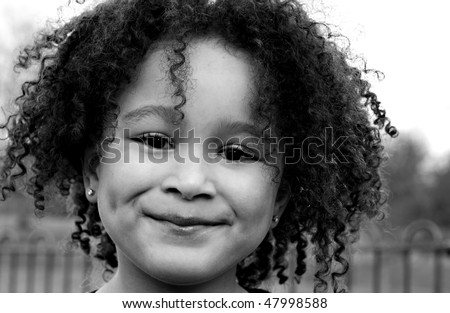 Young black baby girl with curly hair - stock photo