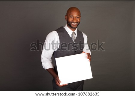 Young black business man wearing a suite and tie - stock photo