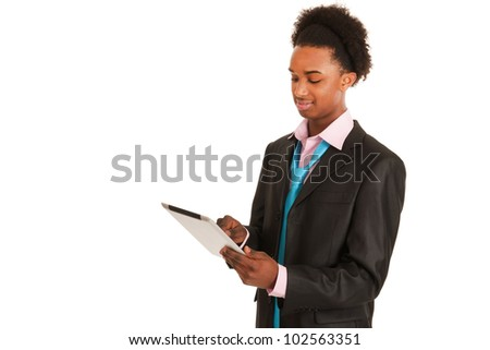 Young black business man with tablet PC in studio