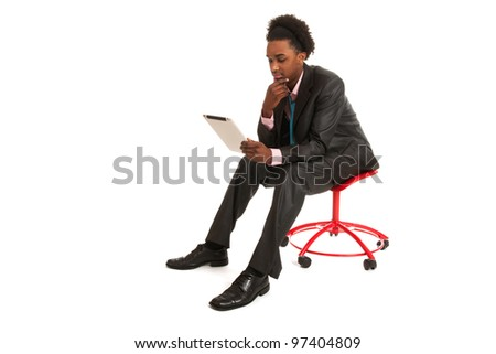 Young black business man with tablet PC in studio - stock photo