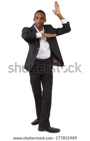 young black businessman doing theatrical dance poses - stock photo