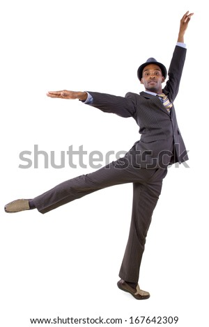 young black businessman in a suit dancing  - stock photo