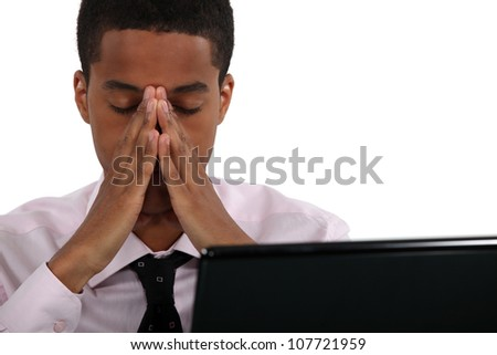 young black businessman looking tired - stock photo