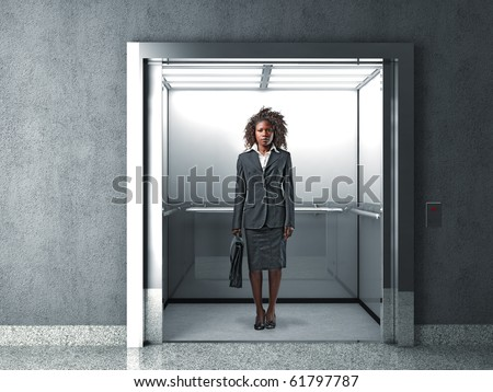 young black businesswoman in modern elevator