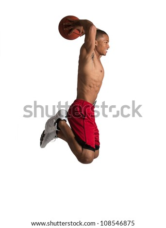 Young Black College Student Jump Slam Dunk Basket Ball on Isolated White Background - stock photo