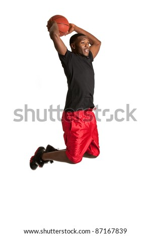 Young Black College Student Playing Basket Ball on Isolated White Background - stock photo