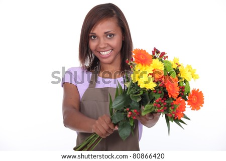 young black female florist taking a flowers bouquet - stock photo