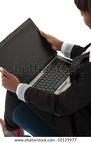 Young black female with open laptop in lap - stock photo