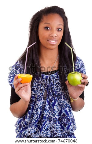 Young black girl holding fruits