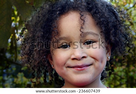 Young black girl with a beautiful smile - stock photo