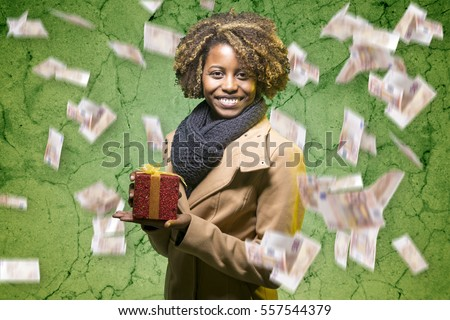 Young black girl with a gift