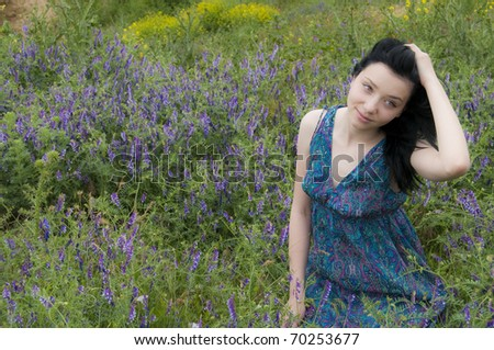 Young Black Hair Girl in Blue Flowers - stock photo