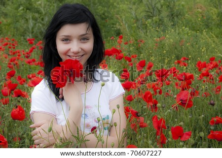 Young Black Hair Girl in red poppies field - stock photo