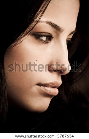 young black hair woman portrait in dark - stock photo
