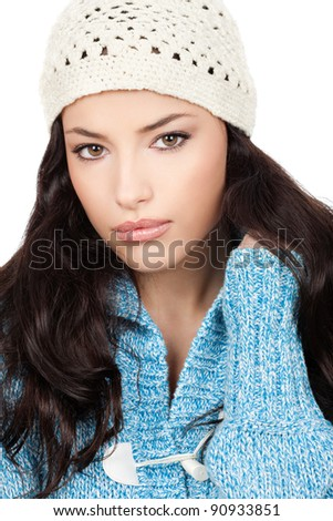 young black hair woman with white cap and blue wool sweater, isolated on white