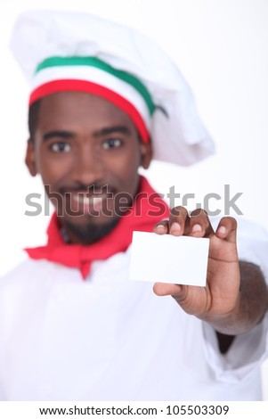 young black Italian cook showing a professional card - stock photo