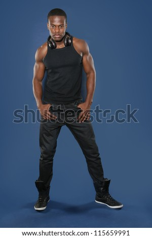 Young black male in a vest and jeans