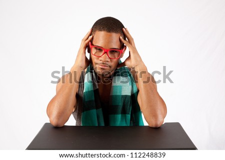 Young black man holding his head like he has a headache - stock photo