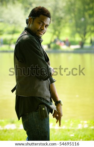 Young black man in casual clothing. - stock photo