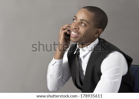 Young Black Man in office behind his desk - stock photo