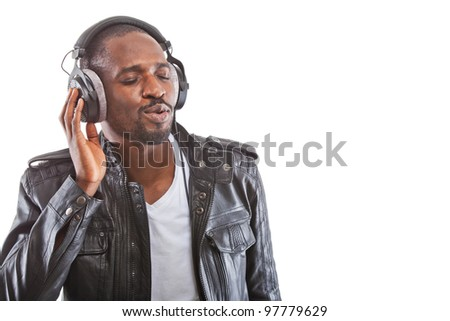 Young black man listening to music over his headphones. - stock photo