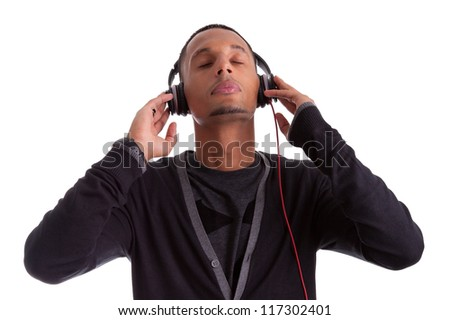 Young black man with closed eyes listening to music, isolated on white background - stock photo
