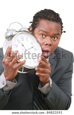 Young black man with large alarm clock - stock photo