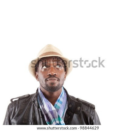 Young black man with stylish clothes looking up - isolated over white background. - stock photo