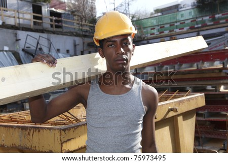 young black man working in the yard