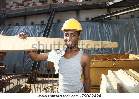 young black man working in the yard - stock photo