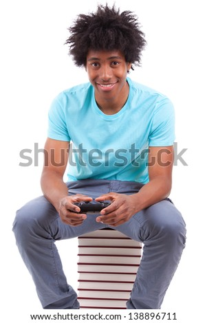 Young black teenage men playing video games, isolated on white background - African people - stock photo