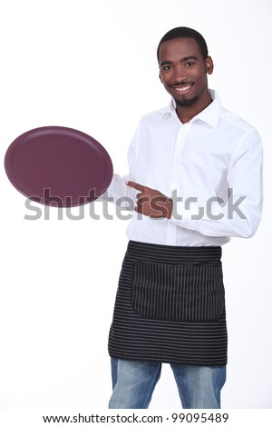 young black waiter showing his platter - stock photo