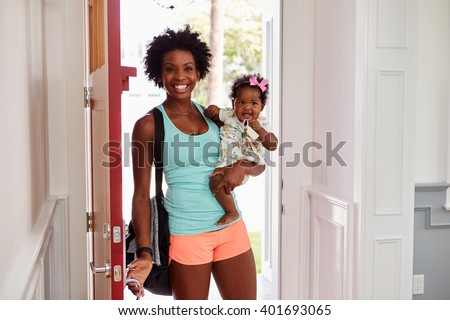 Young black woman and child arrive home after exercising - stock photo