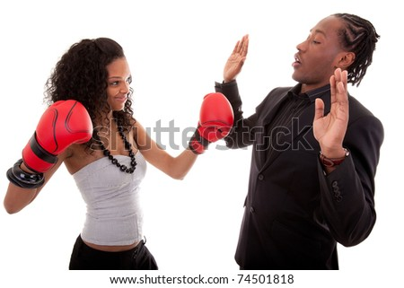 Young black woman and men boxing